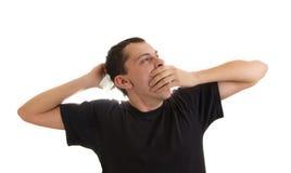 Homem que boceja e que estica Fotografia de Stock