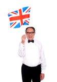 Homem que cheering para Reino Unido. Bandeira de ondulação Imagem de Stock