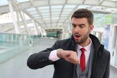 Homem que chega tarde a uma nomeação Imagem de Stock Royalty Free