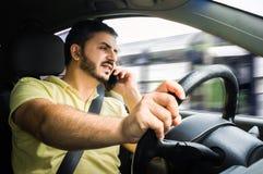 Homem que conduz seu carro Fotografia de Stock Royalty Free