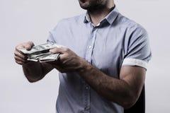Homem que conta o dinheiro Imagem de Stock Royalty Free