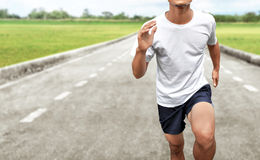 Homem que corre sobre fora Fotos de Stock Royalty Free