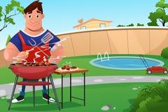 Homem que cozinha o BBQ Fotos de Stock Royalty Free