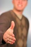 Homem que dá um aperto de mão fotos de stock royalty free