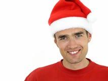 Homem que desgasta um chapéu do Natal fotografia de stock