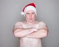 Homem que desgasta um chapéu de Santa Imagens de Stock
