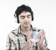 Homem que escuta alguma música Imagem de Stock