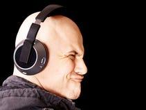 Homem que escuta a música Imagens de Stock