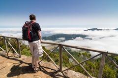 Homem que está em um ponto de vista em Madeira Imagem de Stock Royalty Free
