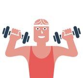Homem que exercita em um gym Imagem de Stock