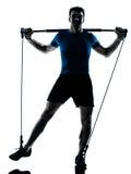 Homem que exercita a postura da aptidão do exercício do gymstick fotos de stock