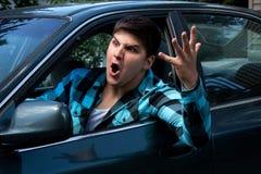 Homem que expressa a raiva da estrada Fotografia de Stock Royalty Free