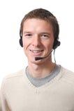 Homem que fala com auriculares Fotografia de Stock Royalty Free