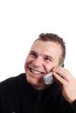 Homem que fala em seu móbil Imagem de Stock