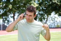 Homem que fala no telefone móvel Fotos de Stock