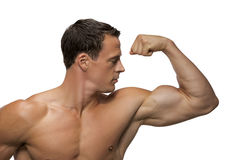Homem que faz o músculo Imagens de Stock