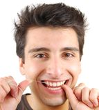 Homem que flossing seus dentes Fotos de Stock Royalty Free