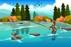 Homem que flyfishing em um rio Imagens de Stock Royalty Free