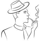 Homem que fuma uma tubulação Fotografia de Stock