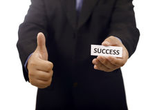 Homem que guarda de papel com texto do sucesso Fotografia de Stock Royalty Free
