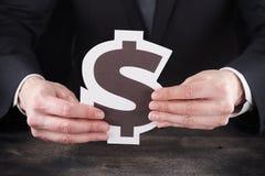 Homem que guarda o ícone do dólar nas mãos Imagem de Stock Royalty Free
