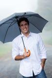 Homem que guarda o guarda-chuva Imagens de Stock Royalty Free
