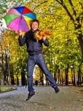 Homem que guarda o guarda-chuva do outono Fotografia de Stock Royalty Free