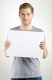 Homem que guarda o sinal Fotos de Stock Royalty Free