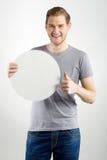 Homem que guarda o sinal Foto de Stock