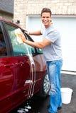 Homem que lava o carro Imagens de Stock Royalty Free