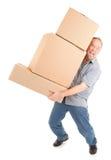 Homem que leva dolorosamente caixas Fotos de Stock