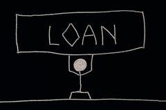 Homem que leva o peso de um empréstimo, Fotografia de Stock Royalty Free
