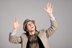 Homem que levantou suas mãos Imagens de Stock Royalty Free
