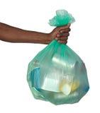 Homem que mantém um saco de plástico completo do lixo Fotografia de Stock Royalty Free