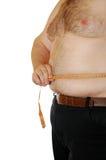 Homem que mede sua barriga Fotos de Stock