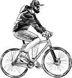 Homem que monta uma bicicleta Imagens de Stock Royalty Free