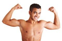 Homem que mostra ambos os músculos do braço imagens de stock royalty free