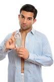Homem que mostra a fragrância do cologne do perfume fotografia de stock royalty free