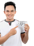 Homem que mostra o dinheiro Fotografia de Stock Royalty Free