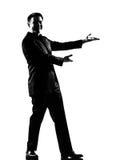 Homem que mostra o gesto que introduz a apresentação Fotografia de Stock Royalty Free