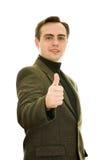 Homem que mostra o thumb-up. Tiro isolado do estúdio. Imagem de Stock Royalty Free