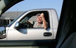 Homem que mostra a raiva da estrada Imagens de Stock Royalty Free