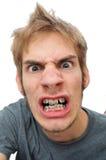 Homem que mostra a seu cintas Foto de Stock