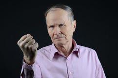 Homem que mostra seu punho Foto de Stock Royalty Free
