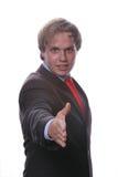 Homem que oferece agitar a mão Foto de Stock Royalty Free