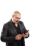 Homem que olha em um PC da tabuleta Foto de Stock Royalty Free