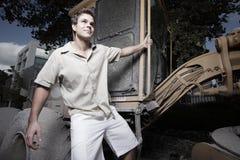 Homem que pendura do equipamento pesado Foto de Stock