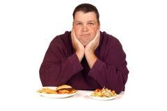 Homem que pensa que comer Imagem de Stock Royalty Free