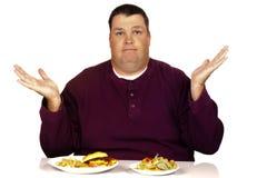 Homem que pensa que comer Fotos de Stock Royalty Free