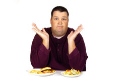 Homem que pensa que comer Imagem de Stock
